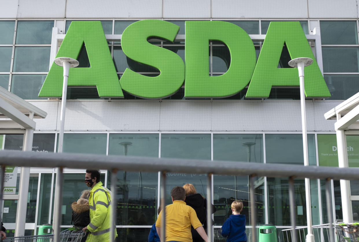 CARMARTHENSHIRE, UNITED KINGDOM - 2021/03/17: People seen outside Asda supermarket in Wales, UK. Eight more people have died with coronavirus in Wales and the overall infection rate has risen slightly. (Photo by May James/SOPA Images/LightRocket via Getty Images)