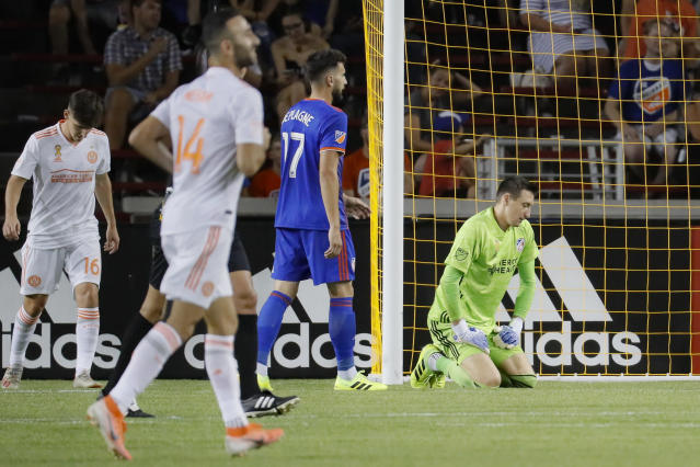 FC Cincinnati goalkeeper Przemyslaw Tyton, right, reacts after giving up a goal to Atlanta United forward Josef Martinez in the second half of an MLS soccer match, Wednesday, Sept. 18, 2019, in Cincinnati. (AP Photo/John Minchillo)