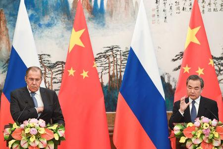 Chinese State Councilor and Foreign Minister Wang Yi speaks during his news conference with Russian Foreign Minister Sergei Lavrov at the Diaoyutai State Guest House in Beijing, China, April 23, 2018. Madoka Ikegami/Pool via REUTERS