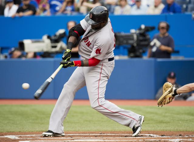 Boston Red Sox's David Ortiz hits a three-run home run against the Toronto Blue Jays during first-inning baseball game action in Toronto, Wednesday, July 23, 2014. (AP Photo/The Canadian Press, Nathan Denette)