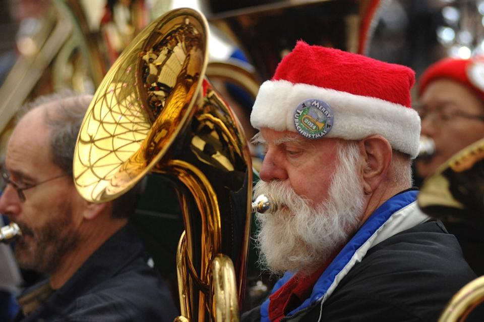 Man playing an instrument on Christmas