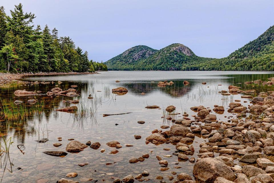 """<p>There are few places as beautiful as Maine's Acadia National Park, and there's one hiking destination within it that's particularly pretty: the Shore Trail that touches <a href=""""https://www.tripadvisor.com/Attraction_Review-g143010-d109738-Reviews-Jordan_Pond-Acadia_National_Park_Mount_Desert_Island_Maine.html"""" rel=""""nofollow noopener"""" target=""""_blank"""" data-ylk=""""slk:Jordan Pond"""" class=""""link rapid-noclick-resp"""">Jordan Pond</a>. It's a 3.5-mile paved path where you'll find an unforgettable view of the idyllic shoreline.</p><p><br><a class=""""link rapid-noclick-resp"""" href=""""https://go.redirectingat.com?id=74968X1596630&url=https%3A%2F%2Fwww.tripadvisor.com%2FAttraction_Review-g143010-d109738-Reviews-Jordan_Pond-Acadia_National_Park_Mount_Desert_Island_Maine.html&sref=https%3A%2F%2Fwww.countryliving.com%2Flife%2Ftravel%2Fg24487731%2Fbest-hikes-in-the-us%2F"""" rel=""""nofollow noopener"""" target=""""_blank"""" data-ylk=""""slk:PLAN YOUR HIKE"""">PLAN YOUR HIKE</a></p>"""