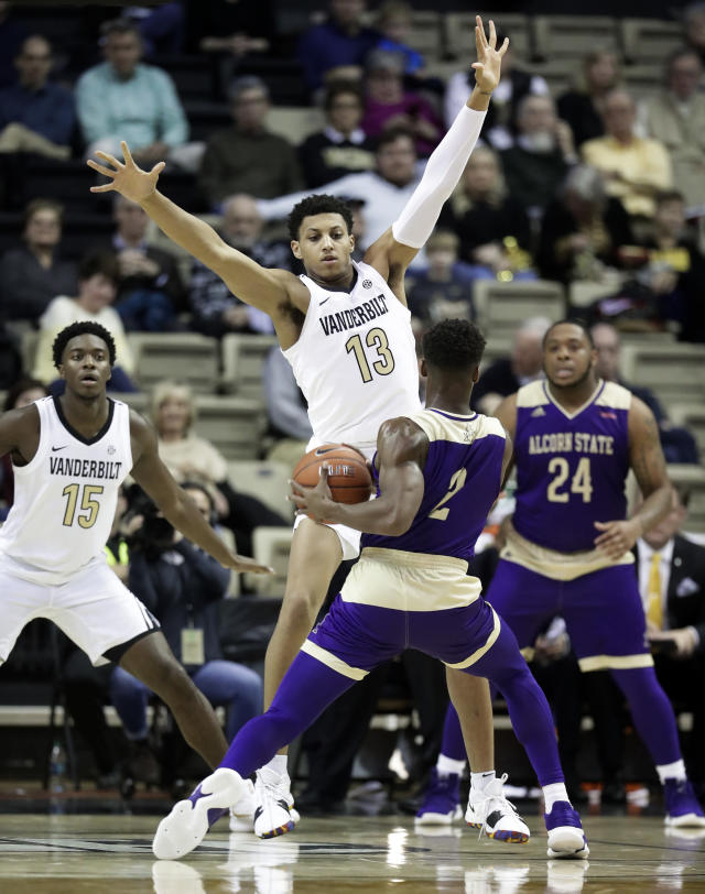 Vanderbilt forward Matthew Moyer (13) blocks the path of Alcorn State guard Jael Scott (2) in the first half of an NCAA college basketball game Friday, Nov. 16, 2018, in Nashville, Tenn. (AP Photo/Mark Humphrey)
