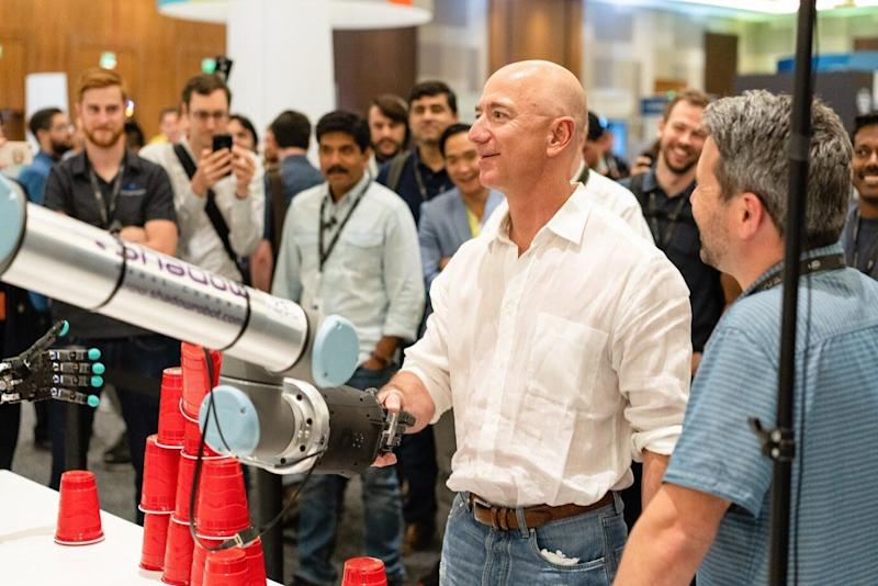 <strong>A Shadow Robot Company creation shakes hands with Amazon founder, Jeff Bezos.</strong> (Photo: Shadow Robot Company)