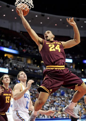 Arizona State guard Trent Lockett (24) gets by UCLA forward David Wear (12) as he drives to the basket during the first half of an NCAA college basketball game, Saturday, Jan. 7, 2012, in Anaheim, Calif. (AP Photo/Gus Ruelas)
