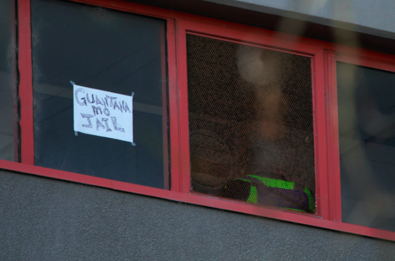 A sign on one window compares the situation to jail. (Reuters)