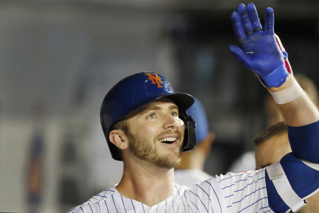 New York Mets' Pete Alonso celebrates in the dugout after hitting a solo home run during the fifth inning of a baseball game against the Arizona Diamondbacks, Monday, Sept. 9, 2019, in New York. It was Alonso's second home run of the game. (AP Photo/Kathy Willens)