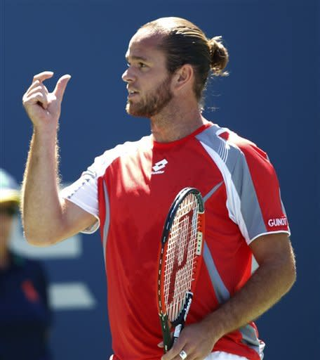 Xavier Malisse of Belgium gestures during his match with John Isner in the second round of play at the 2012 US Open tennis tournament, Wednesday, Aug. 29, 2012, in New York. (AP Photo/Mel C. Evans)