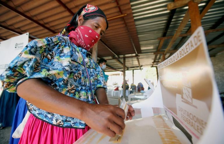 A woman casts her vote at a polling station in Mexico's western state of Jalisco