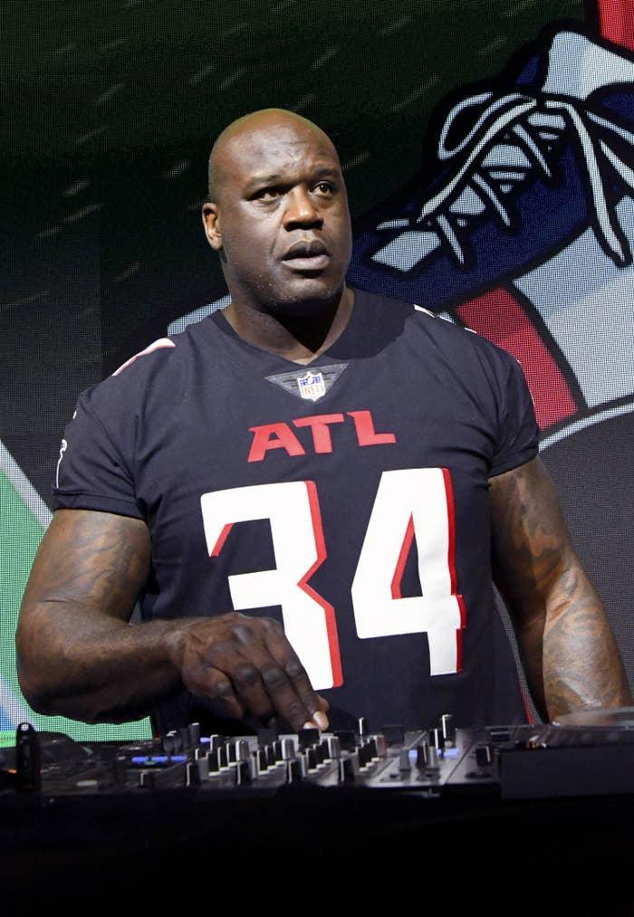 Shaq acting as a dj at an event