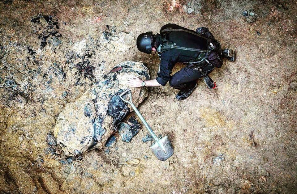 <p>A policeman checks the 1,000 pound World War II bomb unearthed in Wanchai District on Jan. 27, 2018 in Hong Kong, China. A 140-centimeter-long, 1,000 pound World War II bomb was discovered 15 meters underground at a construction site in Wanchai on Saturday in Hong Kong. Police evacuated 1,300 people before defusing the bomb. Photo from Police/China News Service/VCG via Getty Images. </p>