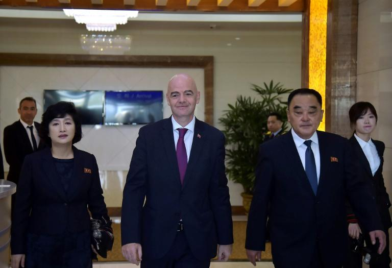 FIFA president Gianni Infantino (C) flew in to Pyongyang and was scheduled to attend the game