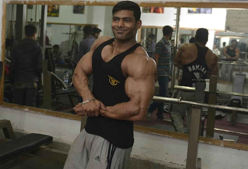 d9cff840cf132 Stani Bodybuilder Salman Ahmed Poses For A Photograph At His Gym The Body  Shape Fitness