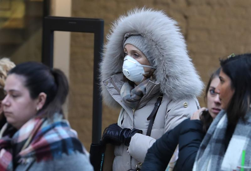 A woman wearing a protective face mask in Oxford Street in London, as Health Secretary Matt Hancock has said ministers are yet to make a decision on whether to ban gatherings of over 500 people in the rest of the UK, after Scotland said it would bring in restrictions from Monday.