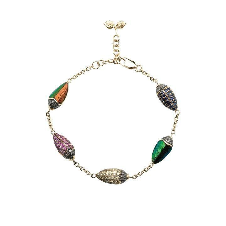 """<p><a class=""""link rapid-noclick-resp"""" href=""""https://bibivandervelden.com/products/scarab-multicolor-bracelet?_pos=3&_sid=e2518c557&_ss=r"""" rel=""""nofollow noopener"""" target=""""_blank"""" data-ylk=""""slk:SHOP NOW"""">SHOP NOW</a></p><p>Famed for her innovative use of materials and her ability to reinterpret all things creepy into desirable, wearable art, the Amsterdam-based designer Bibi Van Der Velden manages to make shimmering scarab beetles into something positively charming. </p><p>Yellow gold and multi-coloured diamond and sapphire bracelet, £5,673, Bibi Van Der Velden</p>"""
