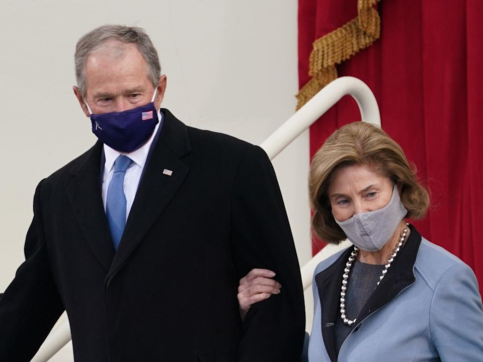 Former President George W Bush and his wife Laura Bush arrive for the inauguration ceremony of Joe Biden as the 46th President of the United States on the West Front of the CapitolREUTERS