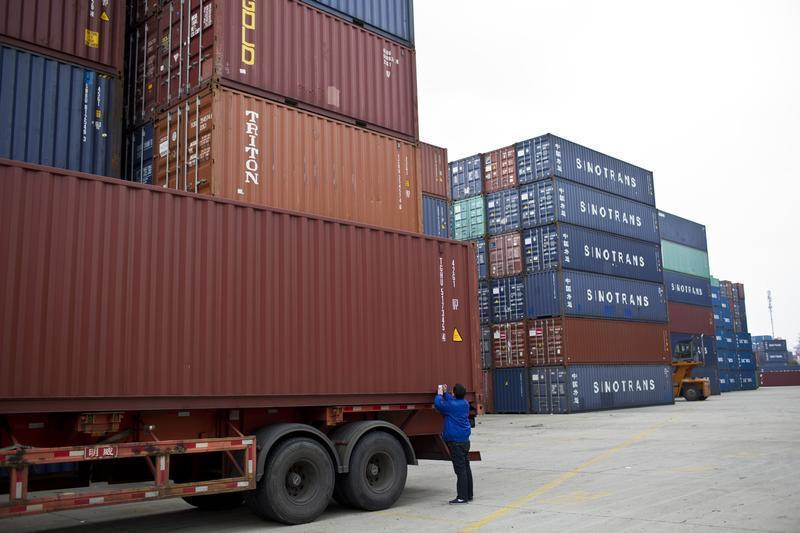 An employee takes notes at a port of Shanghai Free Trade Zone