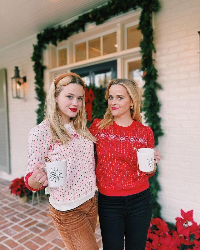 """<p>The doppelgänger mother-daughter duo of the century are confusing us yet again with their scarily similar appearances ahead of Christmas.</p><p>On December 7, the Big Little Lies actress shared a photograph of herself and her 21-year-old in matching Christmas jumpers, noting that she had to 'beg' her daughter to wear the festive outfit but that they look 'cute' in the red and white looks.</p><p>Witherspoon's famous friends noted the similarity between the pair, with writer Derek Blasberg commenting on the snap: 'Thank you for tagging so I could tell which was which.'</p><p>TV presenter Padma Lakshmi wrote: 'I'm seeing double!' </p><p><a href=""""https://www.instagram.com/p/CIgdBPbgGfz/?utm_source=ig_web_copy_link"""" rel=""""nofollow noopener"""" target=""""_blank"""" data-ylk=""""slk:See the original post on Instagram"""" class=""""link rapid-noclick-resp"""">See the original post on Instagram</a></p>"""