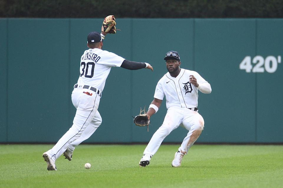 Detroit Tigers second baseman Harold Castro (30) and center fielder Akil Baddoo (60) are unable to make a catch during the game inning against the Tampa Bay Rays at Comerica Park, Sept. 12, 2021.