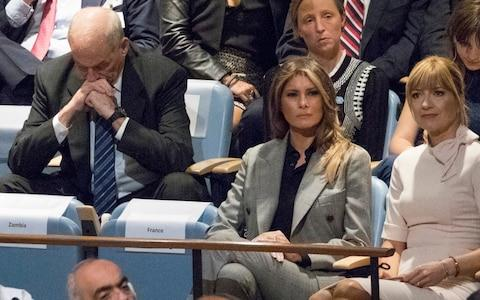 White House Chief of Staff John Kelly, left, reacts as he and first lady Melania Trump listen to U.S. President Donald Trump speak at the United Nations General Assembly  - Credit: AP