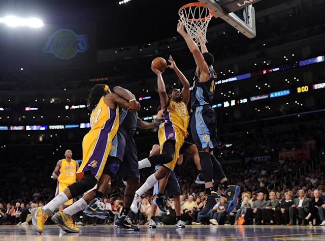 LOS ANGELES, CA - MAY 12: Andrew Bynum #17 of the Los Angeles Lakers goes up for a shot over JaVale McGee #34 of the Denver Nuggets in the first half in Game Seven of the Western Conference Quarterfinals in the 2012 NBA Playoffs on May 12, 2012 at Staples Center in Los Angeles, California. NOTE TO USER: User expressly acknowledges and agrees that, by downloading and or using this photograph, User is consenting to the terms and conditions of the Getty Images License Agreement. (Photo by Harry How/Getty Images)