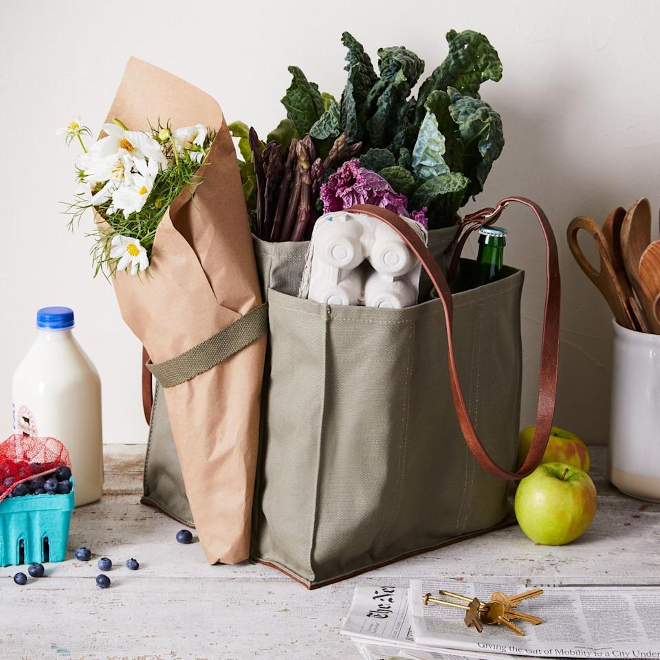 """If they've been experimenting a lot and taking tons of trips to their local farmers' market, your friend will love this tote. It has pockets so that everything stays in place and even aseatbelt for flowers. <a href=""""https://fave.co/3etkaOE"""" target=""""_blank"""" rel=""""noopener noreferrer"""">Find it for $65 at Food52</a>."""