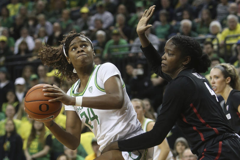 Oregon's Ruthy Hebard, left, looks for a shot against Stanford's Nadia Fingall during the second quarter of an NCAA college basketball game in Eugene, Ore., Thursday, Jan. 16, 2020. (AP Photo/Chris Pietsch)