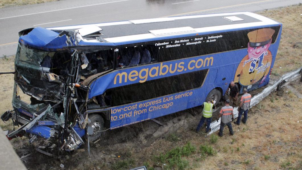 The wreckage of a Megabus is removed from the bridge support pilar that it slammed into after blowing a tire, Thursday, Aug. 2, 2012 in Litchfield, Ill. Illinois State Police Trooper Doug Francis said at least one person was killed in the afternoon wreck which was traveling from Chicago to Kansas City. He didn't immediately have other details about the death. (AP Photo/Tom Gannam)