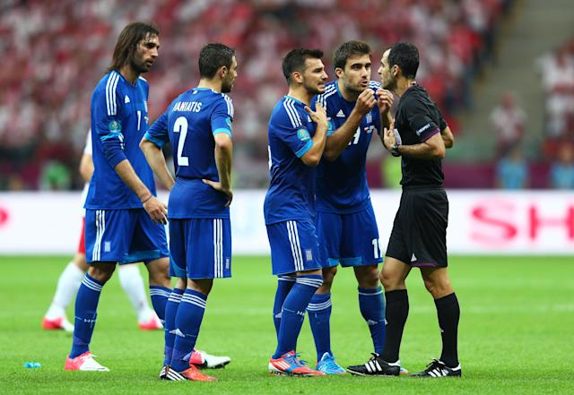 WARSAW, POLAND - JUNE 08: Sokratis Papastathopoulos of Greece appeals to the Referee Carlos Velasco Carballo before he is sent off after receiving a second yellow card during the UEFA EURO 2012 group A match between Poland and Greece at The National Stadium on June 8, 2012 in Warsaw, Poland. (Photo by Michael Steele/Getty Images)