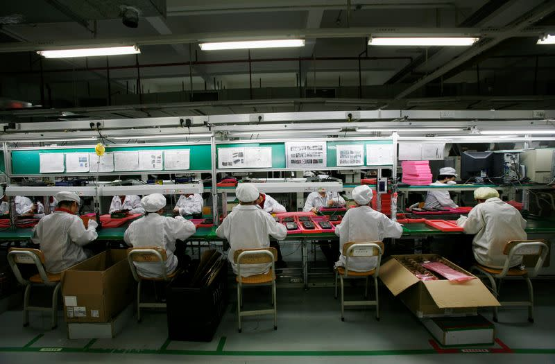 FILE PHOTO: Workers are seen inside a Foxconn factory in the township of Longhua in the southern Guangdong province