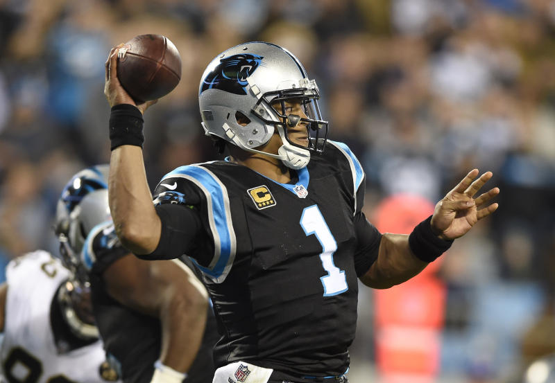Carolina Panthers&#x27 Cam Newton looks to pass against the New Orleans Saints in the first half of an NFL football game in Charlotte N.C. Monday Dec. 17 2018