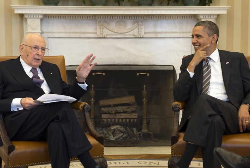 In this photo provided by the Italian Presidency press office, President Barack Obama talks with Italian President Giorgio Napolitano during their meeting in the Oval Office of the White House, in Washington, Friday, Feb. 15, 2013. (AP Photo/Paolo Giandotti, Italian Presidency Press Office, ho)