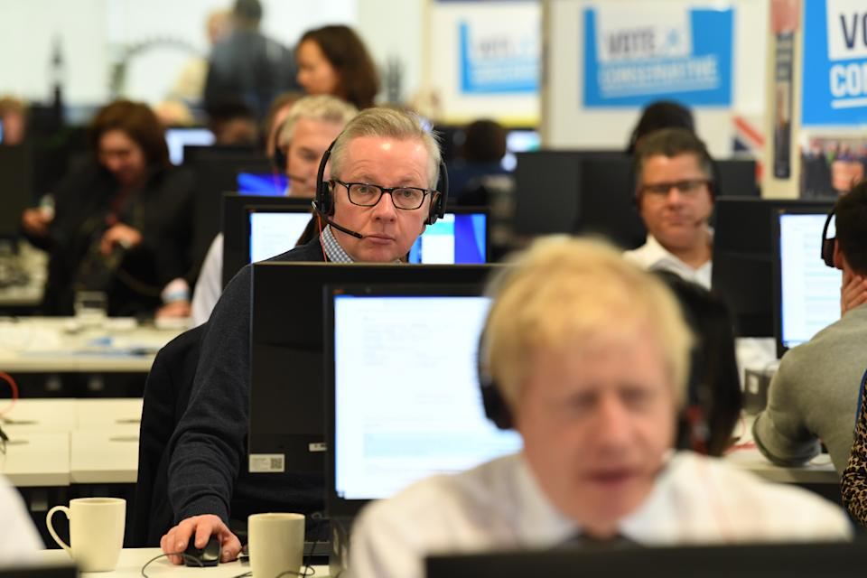 Chancellor of the Duchy of Lancaster Michael Gove with other members of the Cabinet at Conservative Campaign Headquarters Call Centre, London, while on the election campaign trail.