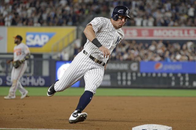 New York Yankees' Mike Tauchman runs past third base to score on a double by Aaron Judge during the fourth inning of a baseball game Tuesday, Aug. 13, 2019, in New York. (AP Photo/Frank Franklin II)