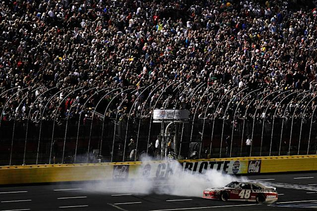 CHARLOTTE, NC - MAY 19: Jimmie Johnson, driver of the #48 Lowe's Patriotic Chevrolet, celebrates with a burnout after winning the NASCAR Sprint All-Star Race at Charlotte Motor Speedway on May 19, 2012 in Charlotte, North Carolina. (Photo by Jeff Zelevansky/Getty Images for NASCAR)