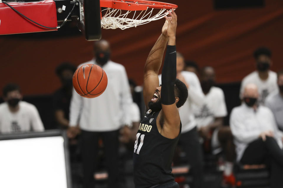 Colorado's Jeriah Horne (41) dunks against Oregon State during the first half of an NCAA college basketball game in Corvallis, Ore., Saturday, Feb. 20, 2021. (AP Photo/Amanda Loman)