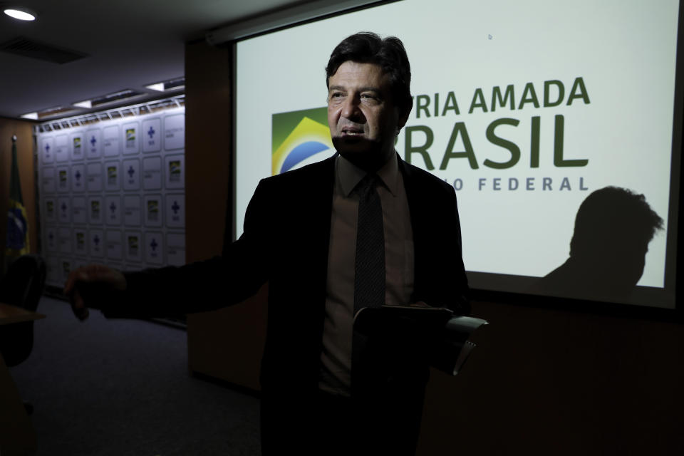 Brazil's Health Minister Luiz Henrique Mandetta speaks to the press before a press conference with members of the Brazilian Ministry of Health's Operational Emergency Coronavirus Committee in Brasilia, Brazil, Friday, Jan. 31, 2020. Brazil's government set up the committee as a precautionary measure amid an outbreak of the coronavirus that started in China. (AP Photo/Eraldo Peres)
