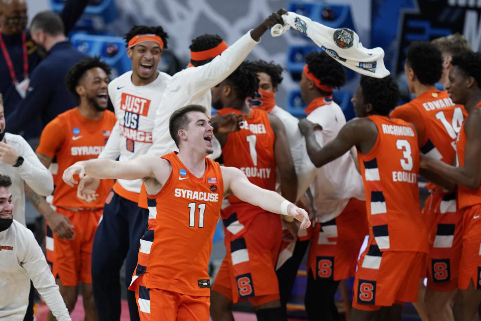 Syracuse's Joseph Girard III celebrates following a second-round game against West Virginia in the NCAA men's college basketball tournament at Bankers Life Fieldhouse, Sunday, March 21, 2021, in Indianapolis. Syracuse defeated Syracuse 75-72. (AP Photo/Darron Cummings)