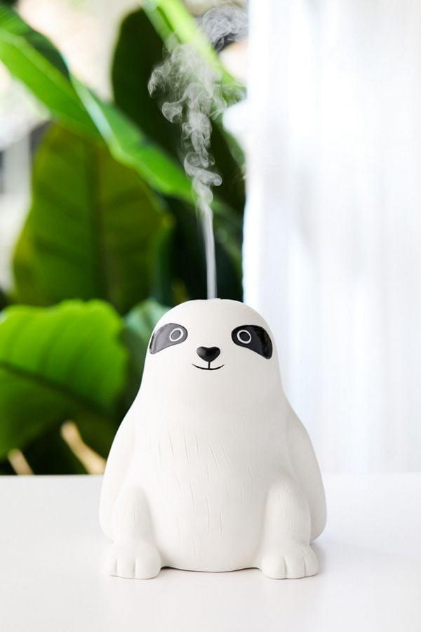 """<p>The <a href=""""https://www.popsugar.com/buy/Sloth-Essential-Oil-Diffuser-489424?p_name=Sloth%20Essential%20Oil%20Diffuser&retailer=urbanoutfitters.com&pid=489424&price=69&evar1=casa%3Aus&evar9=46600175&evar98=https%3A%2F%2Fwww.popsugar.com%2Fphoto-gallery%2F46600175%2Fimage%2F46600196%2FSloth-Essential-Oil-Diffuser&list1=urban%20outfitters%2Chome%20decor%2Cessential%20oils%2Csloth&prop13=api&pdata=1"""" rel=""""nofollow"""" data-shoppable-link=""""1"""" target=""""_blank"""" class=""""ga-track"""" data-ga-category=""""Related"""" data-ga-label=""""http://www.urbanoutfitters.com/shop/sloth-essential-oil-diffuser?category=wellness-products&amp;color=010&amp;type=REGULAR"""" data-ga-action=""""In-Line Links"""">Sloth Essential Oil Diffuser</a> ($69) is made of ceramic, so it can easily be wiped clean.</p>"""