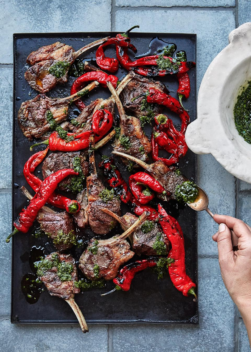 """Lamb chops need enough time on the grill to let the fat render. You'll get flare-ups as the fat melts onto the coals—that's inevitable—but instead of letting the chops char, just move them to a new spot as needed and keep going. <a href=""""https://www.epicurious.com/recipes/food/views/grilled-lamb-chops-and-peppers?mbid=synd_yahoo_rss"""" rel=""""nofollow noopener"""" target=""""_blank"""" data-ylk=""""slk:See recipe."""" class=""""link rapid-noclick-resp"""">See recipe.</a>"""