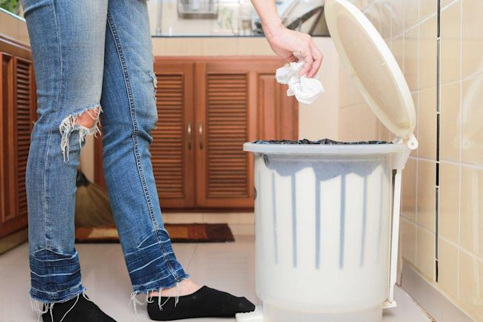 """<p>Even if you always use a liner bag, your trash receptacle gets pretty grimy. The Kitchn suggests that you start the task of <a href=""""https://www.thekitchn.com/how-to-clean-the-kitchen-trash-can-cleaning-lessons-from-the-kitchn-204780"""" rel=""""nofollow noopener"""" target=""""_blank"""" data-ylk=""""slk:cleaning your garbage can"""" class=""""link rapid-noclick-resp"""">cleaning your garbage can</a> by emptying it, removing any large pieces of food or particles you see in the bottom of the can. Then, rinse out the can using either a hose outside or your bathtub. </p><p>Once the can has been thoroughly rinsed, use a disinfectant cleaner to spray down the inside and outside of the trash can and scrub the can with a nylon bristle brush. Afterwards, rinse and dry the can thoroughly. </p>"""