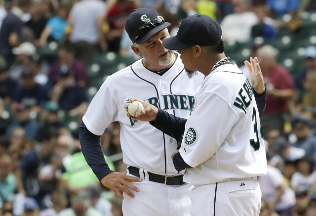 Seattle Mariners starting pitcher Felix Hernandez, right, talks with Mariners pitching coach Carl Willis, left, in the third inning of a baseball game against the Texas Rangers, Wednesday, Aug. 28, 2013, in Seattle. (AP Photo/Ted S. Warren)