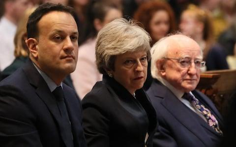 Theresa May, in between Ireland's Prime Minister Leo Varadkar (left) and President Michael Higgins, at the service - Credit: Brian Lawless/PA