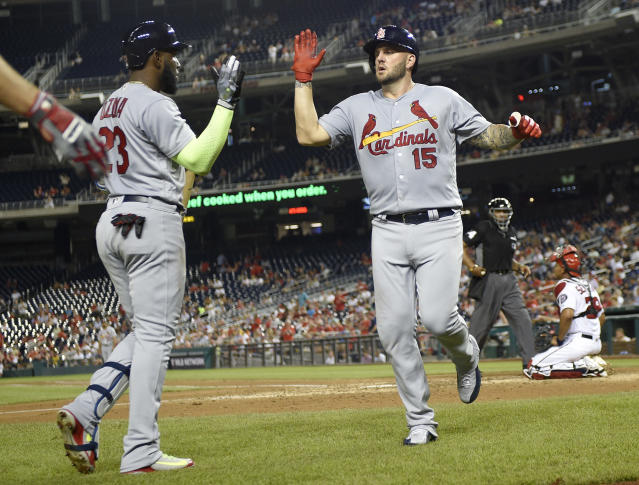 St. Louis Cardinals' Matt Adams (15) celebrates his home run with Marcell Ozuna (23) during the fifth inning of a baseball game against the Washington Nationals, Wednesday, Sept. 5, 2018, in Washington. (AP Photo/Nick Wass)