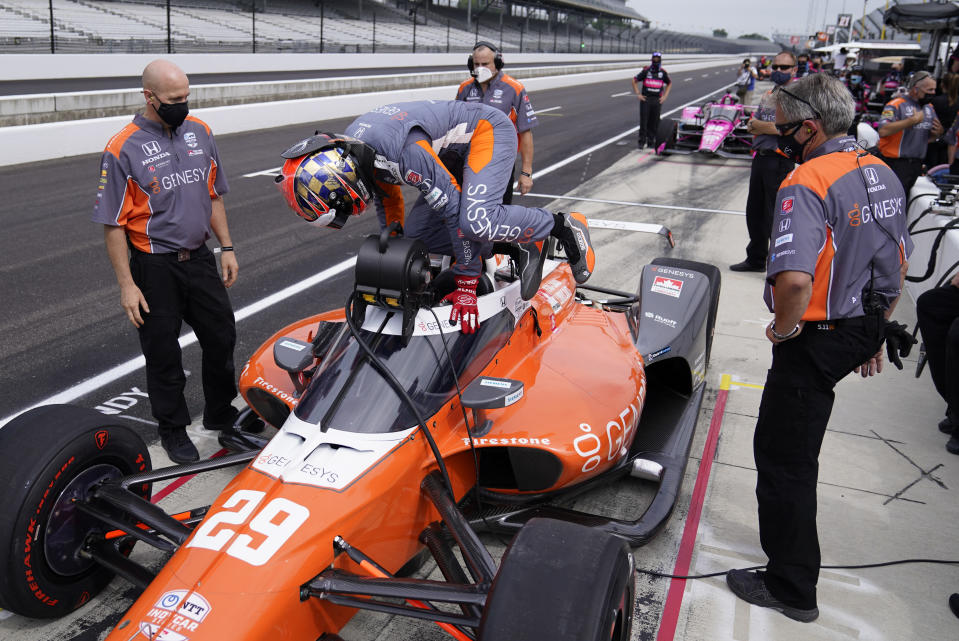 James Hinchcliffe, of Canada, climbs into his car during a practice session for the Indianapolis 500 auto race at Indianapolis Motor Speedway, Wednesday, Aug. 12, 2020, in Indianapolis. (AP Photo/Darron Cummings)