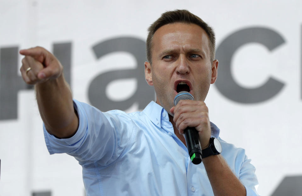 FILE - In this July 20, 2019, file photo, Russian opposition activist Alexei Navalny gestures while speaking to a crowd during a political protest in Moscow. Russia came under renewed pressure to explain the nerve agent attack on opposition figure Alexei Navalny as the annual meeting of the global chemical weapons watchdog got underway in The Hague, Netherlands, Monday Nov. 30, 2020, amid measures aimed at reining in the spread of the coronavirus. (AP Photo/Pavel Golovkin, File)