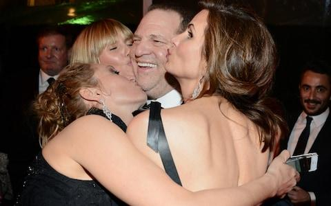 Harvey Weinstein (C) and tv personality Heidi Klum (back, L) and actress Uma Thurman (front, L) attend The Weinstein Company & Netflix's 2014 Golden Globes After Party - Credit: Araya Diaz/Getty