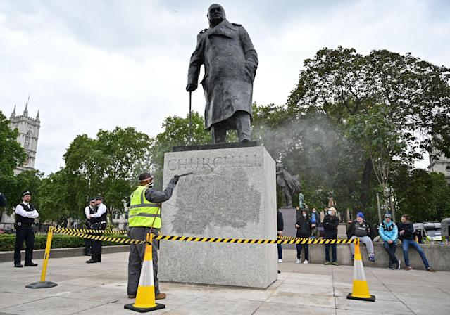 The statue of former prime minister Winston Churchill is cleaned in Parliament Square earlier this week. (Getty)