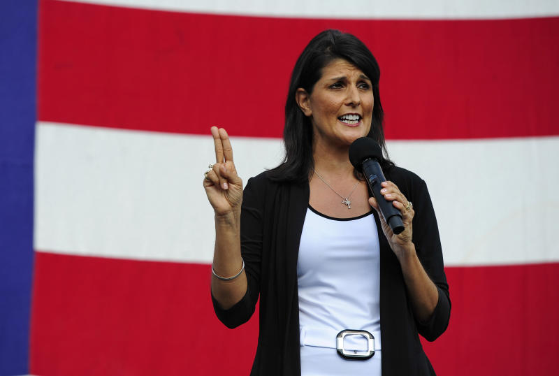 """FILE - In this Aug. 26, 2013, file photo, South Carolina Republican Gov. Nikki Haley announces her candidacy for a second term in Greenville, S.C. The Democratic Party claims to be the natural home for women, but the faces of the nation's governors tell another story. Democrats have just one female governor in their ranks. And the GOP, often accused of waging a """"war on women,"""" boasts four, an advantage that gives Republicans a powerful tool in the broader political fight to attract women voters. (AP Photo/ Richard Shiro, File)"""