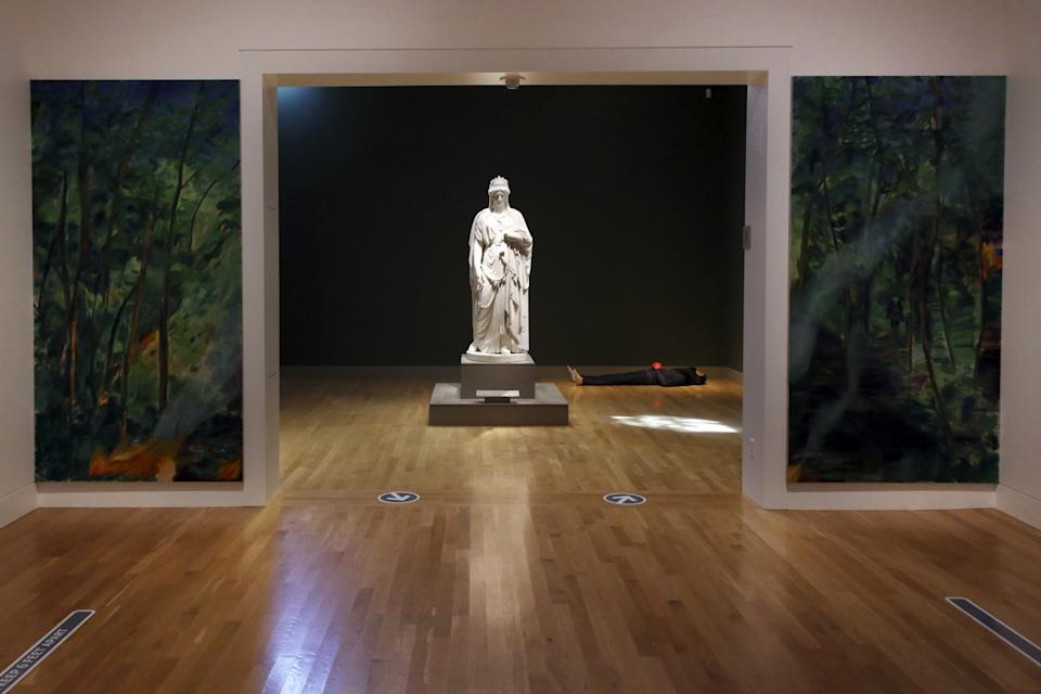 """Jill Mulleady's two-part landscape painting and a Patrick Johnson sculpture flank Harriet Hosmer's 1859 """"Zenobia in Chains"""""""